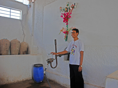 """Look at that happy face! The final product coming out of the distiller. And Carrie, always thirsty, asks, """"When do we head for the bar"""" And Pat, ever curious asks: """"What does the cross signify and what are its origins."""""""
