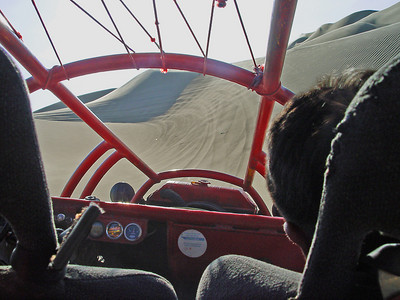 Properly strapped into the buggy, we accelerate at near light speed, slam up the face of a huge dune, then bank, nearly tipping over. Only centrifigal force kept us from being ejected into orbit. Ok, we may be exaggerating a little, but it was pretty thrilling. Check out their website at: http://www.desertadventure.net.