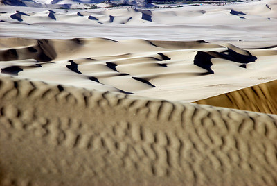 """Hair blown back, sand in teeth, we make our first stop to check out this panorama. WOW! Sand dunes everywhere and the light was incredible. If we were film producers this is where we would come to shoot. """"Ok, take your pictures and let's ride!"""" says the buggy driver."""