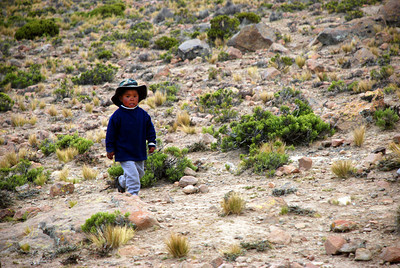 This little boy was sent to collect coins from us as we took pictures of his family's llamas.