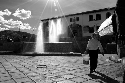 A young boy working a small food stand near the center of Cuzco.