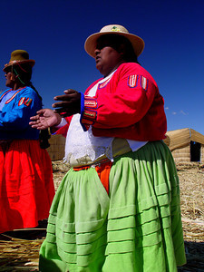 We arrived at one of the reed islands and were greeted by singing Uros women dressed in colorful traditional clothing.