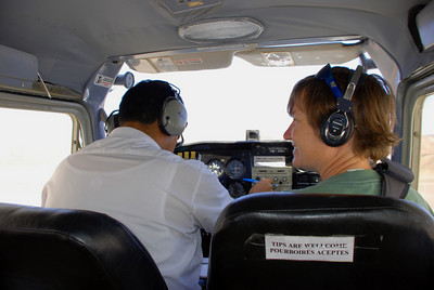 Carrie was our co-pilot, so she thought she was going to get a tip as well. No way! We did wait to tip the pilot until we were safely back on the ground. I'm sure you can guess why. Up, up, and away in our.....