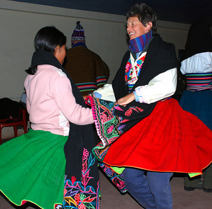 Here is Aly dancing with our host's daughter. No, those are not Aly's clothes. The family dressed us up in their own clothes. I guess they didn't want us to stand out at the dance?
