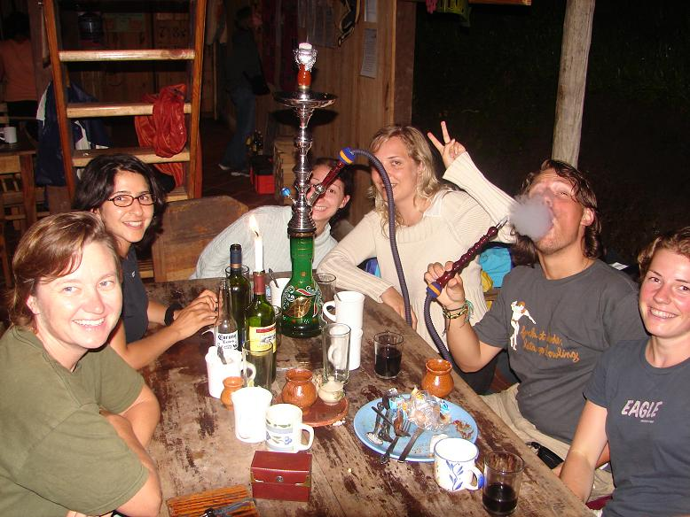 The group enjoying an after dinner dessert; a hookah. A mild tobacco is placed in the bowl at the top and the bottom is filled with a flavored liquid or liquor. These were popular throughout Guatemala. Felix (from Sweden) sure seems to like it!