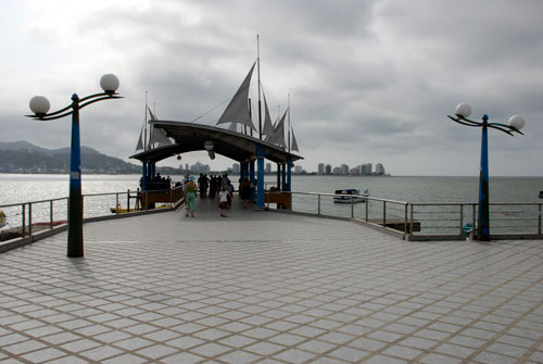 As promised, a picture of the Ferry Landing with the city of Bahia de Caraquez in the background. We didn't have a good place to stick this picture, but we liked it so we just stuck it here at the end. Don't miss Ecuador! You'll love the people and the country. On January 21 we leave the boat for a 3 month adventure (planes/trains/buses) to Chile, Argentina, Uraguay, Brazil, and maybe others. We'll hopefully keep you posted with a new update monthly. We love hearing from you so send an email when you can! Ciao, Pat and Carrie