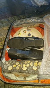 Shoes, sandals, daypack and hat stowed.