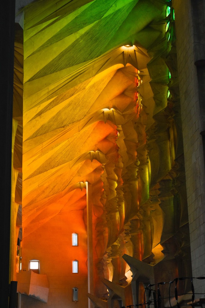 What humans can create! Sagrada Familia, interior wall and ceiling lit by stained glass windows.